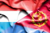 Waving flag of Eritrea and Luxembourg — Stock Photo