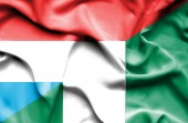 Waving flag of Nigeria and Luxembourg — Stock Photo