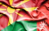 Wapperende vlag van Oman en Macedonië — Stockfoto