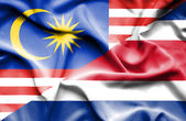 Waving flag of Costa Rica and Malaysia — Stock Photo