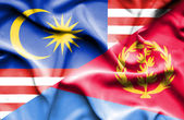 Waving flag of Eritrea and Malaysia — Stock Photo