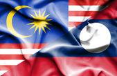Waving flag of Laos and Malaysia — Stock Photo