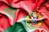 Waving flag of Portugal and Morocco — Stock Photo