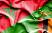 Waving flag of Zimbabwe and Morocco — Stock Photo