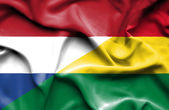 Waving flag of Bolivia and Netherlands — Stock Photo