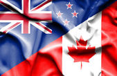 Waving flag of Canada and New Zealand — Stock Photo