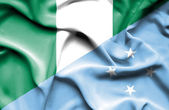 Waving flag of Micronesia and Nigeria — Stock Photo