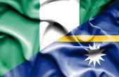 Waving flag of Nauru and Nigeria — Stock Photo