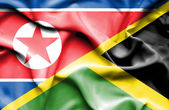 Waving flag of Jamaica and North Korea — Stock Photo