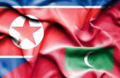 Waving flag of Maldives and North Korea — Stock Photo