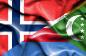 Waving flag of Comoros and Norway — Stock Photo