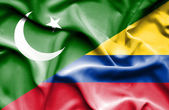 Waving flag of Columbia and Pakistan — Stock Photo
