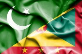 Waving flag of Guernsey and Pakistan — Stock Photo