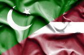 Waving flag of Latvia and Pakistan — Stock Photo