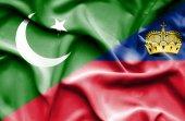 Waving flag of Lichtenstein and Pakistan — Stock Photo