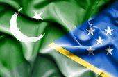 Waving flag of Solomon Islands and Pakistan — Stock Photo