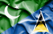 Waving flag of St Lucia and Pakistan — Stock Photo