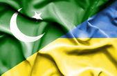 Waving flag of Ukraine and Pakistan — Stock Photo