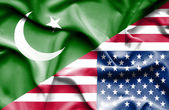 Waving flag of United States of America and Pakistan — Stock Photo