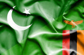Waving flag of Zimbabwe and Pakistan — Stock Photo