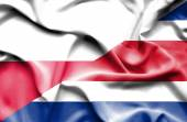 Waving flag of Costa Rica and Poland — Stock Photo