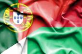 Waving flag of Madagascar and Portugal — Stock Photo