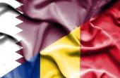 Waving flag of Romania and Qatar — Stock Photo