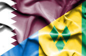 Waving flag of Saint Vincent and Grenadines and Qatar — Stock Photo