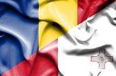 Waving flag of Malta and Romania — Stock Photo