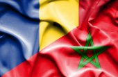 Waving flag of Morocco and Romania — Stock Photo
