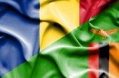Waving flag of Zimbabwe and Romania — Stock Photo