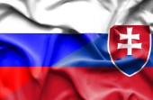 Waving flag of Slovakia and Russia — Stock Photo