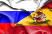 Waving flag of Spain and Russia — Stock Photo