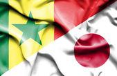 Waving flag of Japan and Senegal — Stock Photo