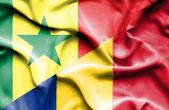 Waving flag of Romania and Senegal — Stock Photo