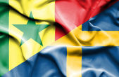 Waving flag of Sweden and Senegal — Stock Photo