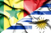 Waving flag of Uruguay and Senegal — Stock Photo