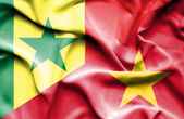 Waving flag of Vietnam and Senegal — Stock Photo