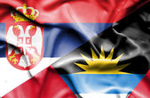Waving flag of Antigua and Barbuda and Serbia — Stock Photo
