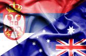 Waving flag of Australia and Serbia — Stock Photo