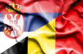 Agitant le drapeau de la Belgique et la Serbie — Photo