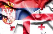 Gürcistan ve sırbistan bayrağı sallayarak — Stok fotoğraf