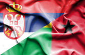 Waving flag of Guinea Bissau and Serbia — Stock Photo