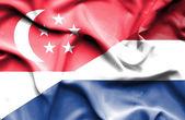 Waving flag of Netherlands and Singapore — Stock Photo