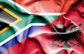 Waving flag of Albania and South Africa — Stock Photo