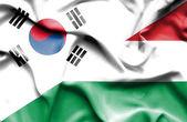 Sventolando la bandiera dell'ungheria e corea del sud — Foto Stock