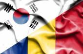 Waving flag of Romania and South Korea — Stock Photo