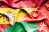 Waving flag of Oman and Spain — Stock Photo
