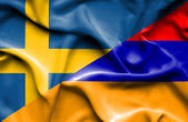 Waving flag of Armenia and Sweden — Stock Photo