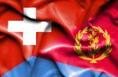 Waving flag of Eritrea and Switzerland — Stock Photo